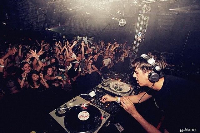A DJ spinning in a club